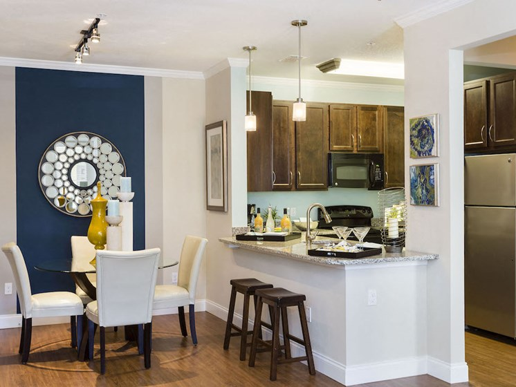 Lake Nona Water Mark Apartments in Lake Nona in ORLANDO, FL 32827 open living and dining room area
