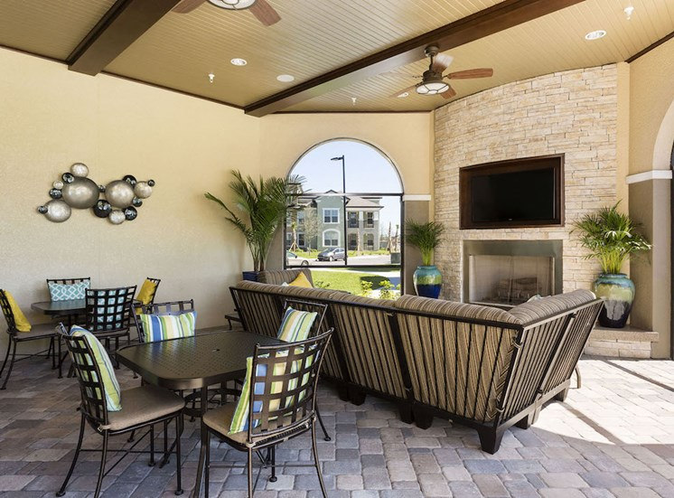 community veranda with seating and fireplace