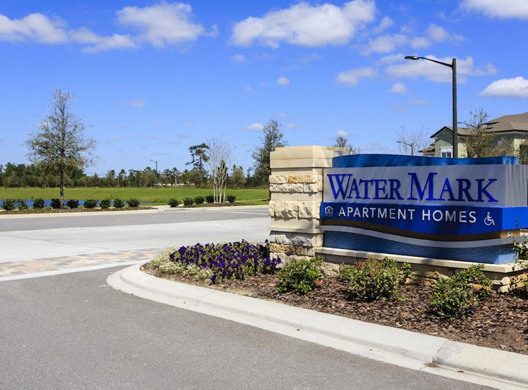 entrance drive and signage at lake nona water mark