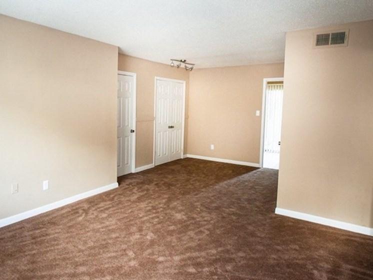 spacious living room with plush carpeting