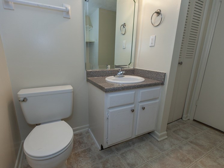 bathroom with vinyl tile flooring