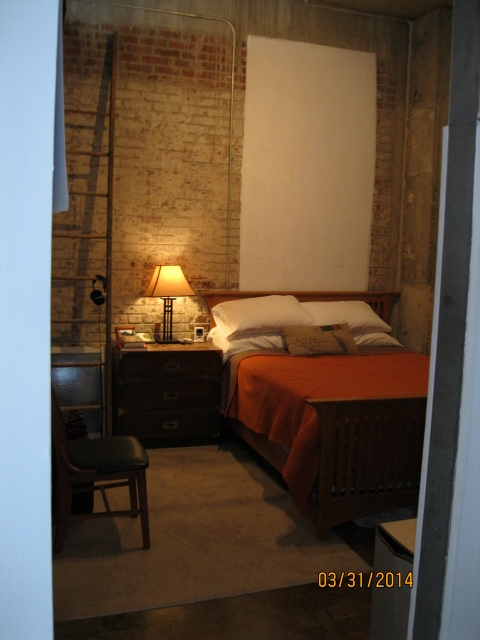 exposed brick bedrooms at  Phoenix Lofts Birmingham, AL 35203