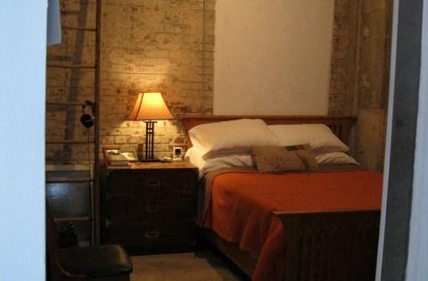 exposed brick bedrooms at  Phoenix Lofts Birmingham, AL 35203