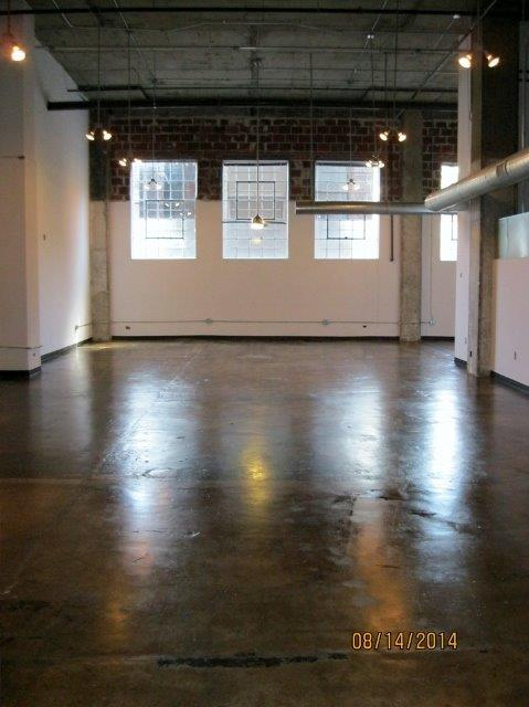 polished floors and large windows at .  Phoenix Lofts Birmingham, AL 35203