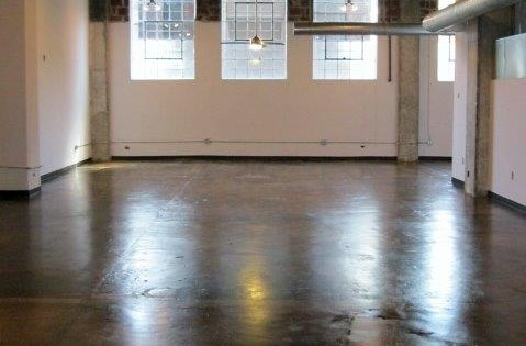 polished floors and large windows at .  Phoenix Lofts Birmingham, AL 35203