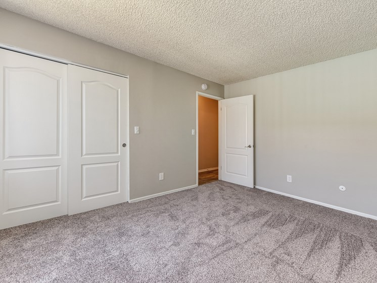 Spacious bedroom with wall to wall carpet and large closet