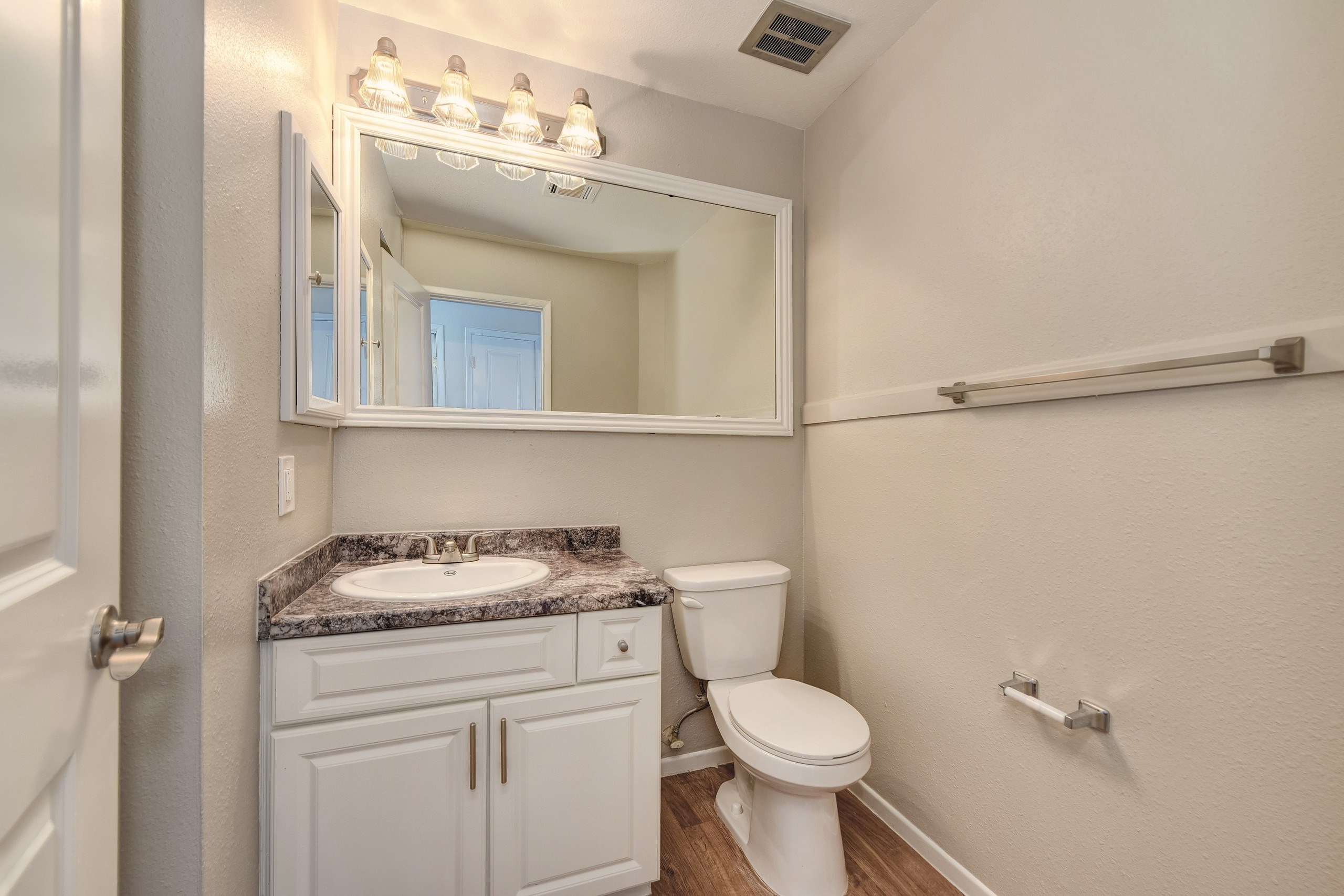 Two Bedroom Bathroom #1, white cabinetry and large mirror