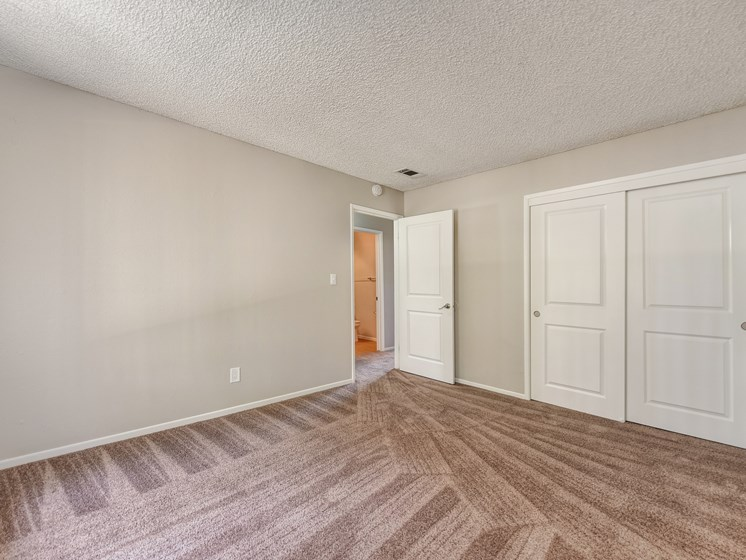 Bedroom 1 with large closets and wall to wall carpet