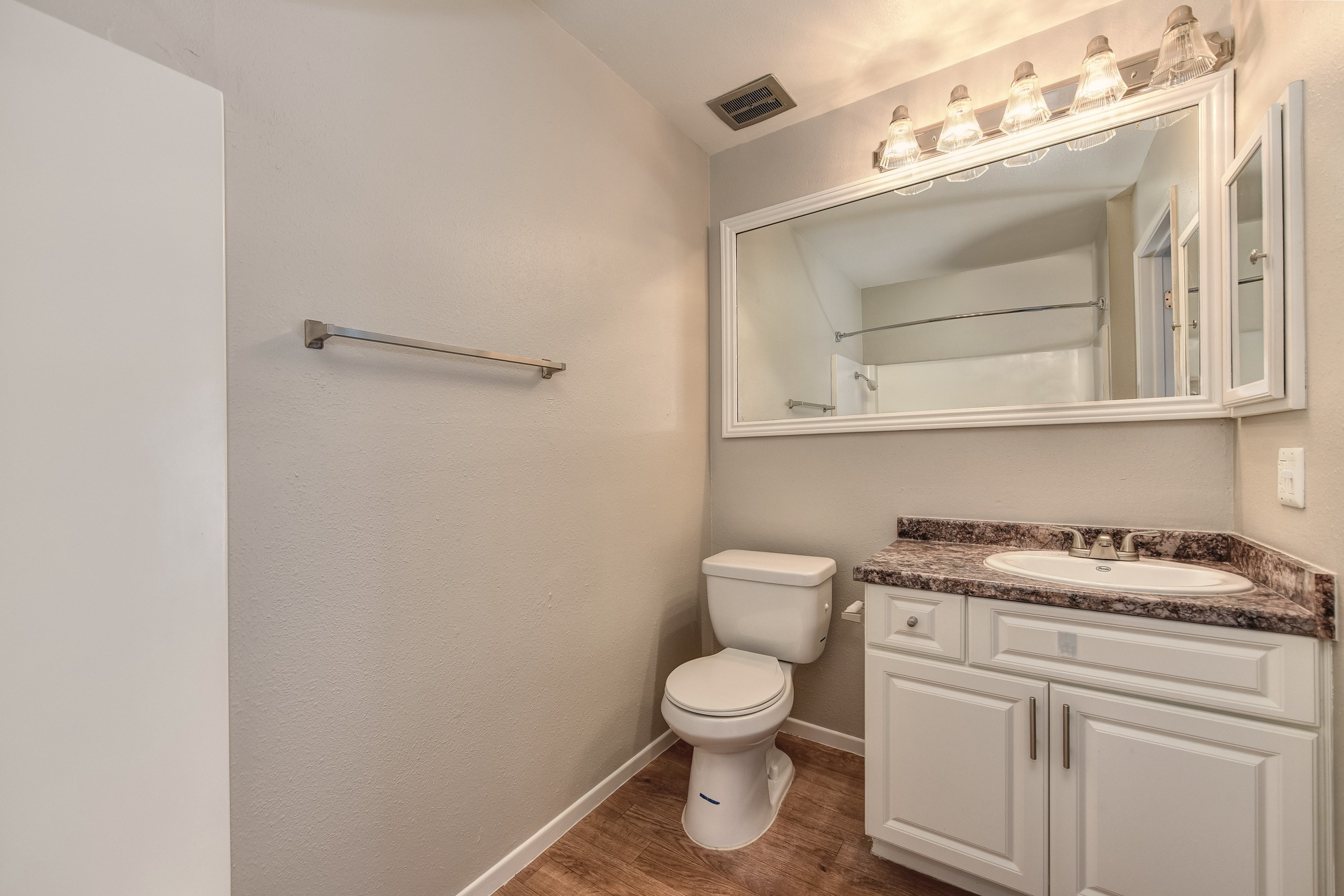 Large Master Bathroom with ample lighting and mirror