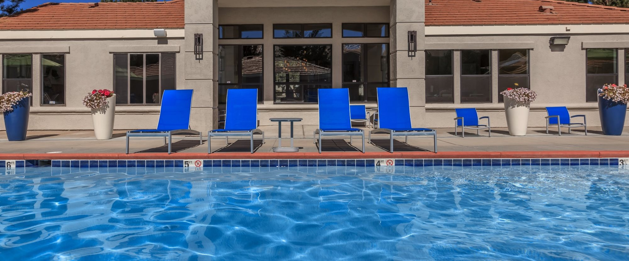 Northtowne Summit Apartments Pool and Lounge Chairs In Front Of Clubhouse