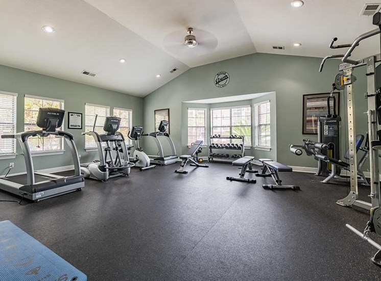 fitness center with treadmills and strength equipment