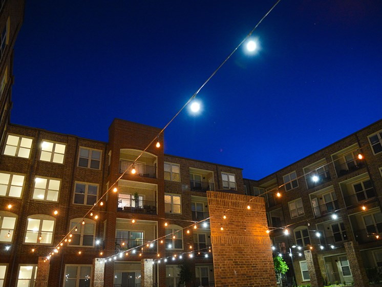 Bell Frisco Market Center apartments courtyard night