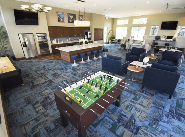 Commuity social lounge with fooseball table and kitchen