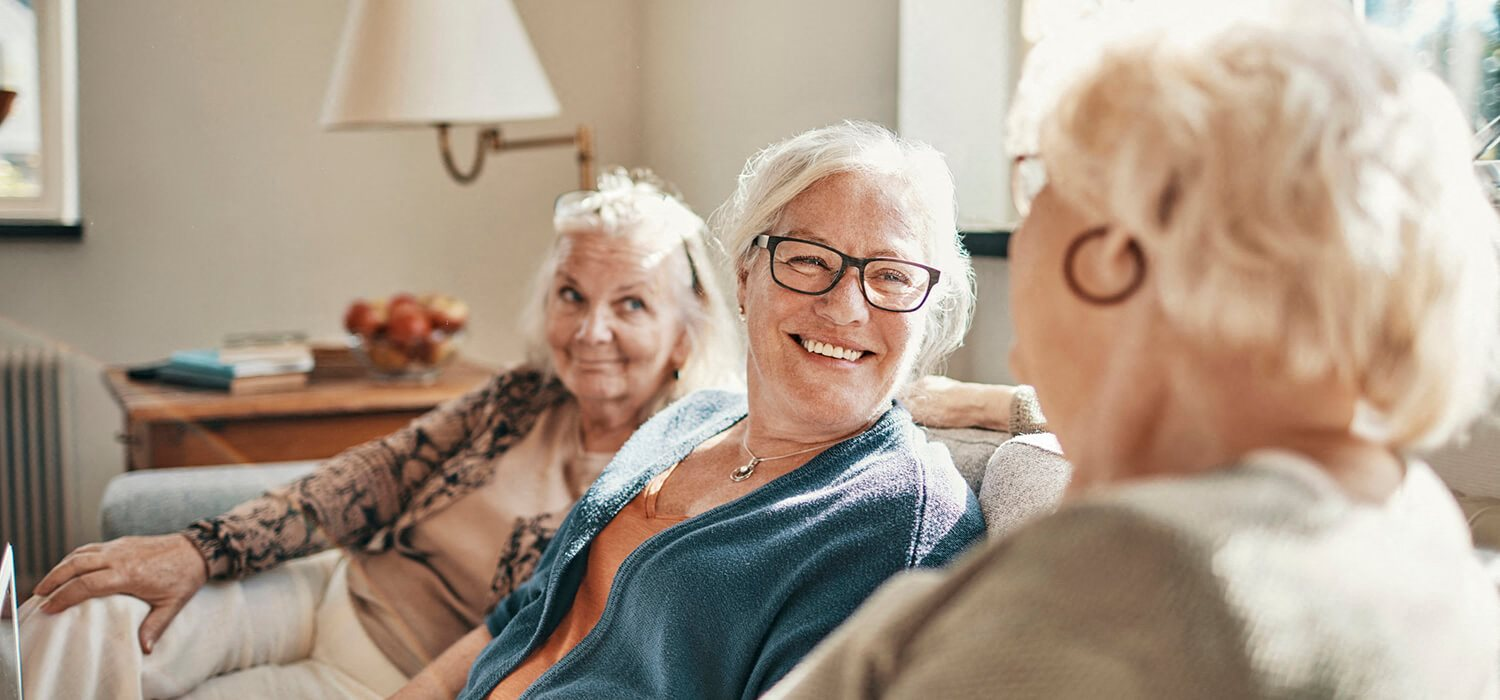 Women laughing at Woodlands at Forbes Lake Apartments in Kirkland WA