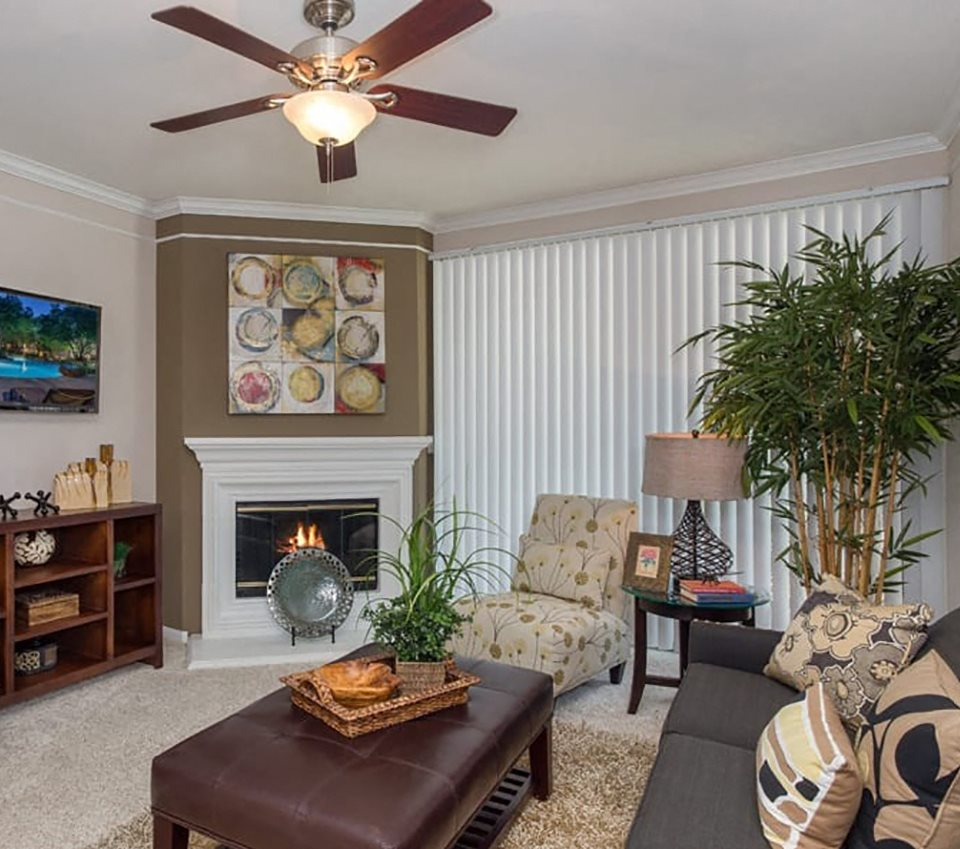 Model apartment home living room with fireplace