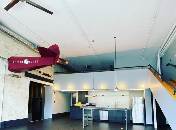 loft with contemporary kitchen, pendant lighting, and half an airplane on the wall