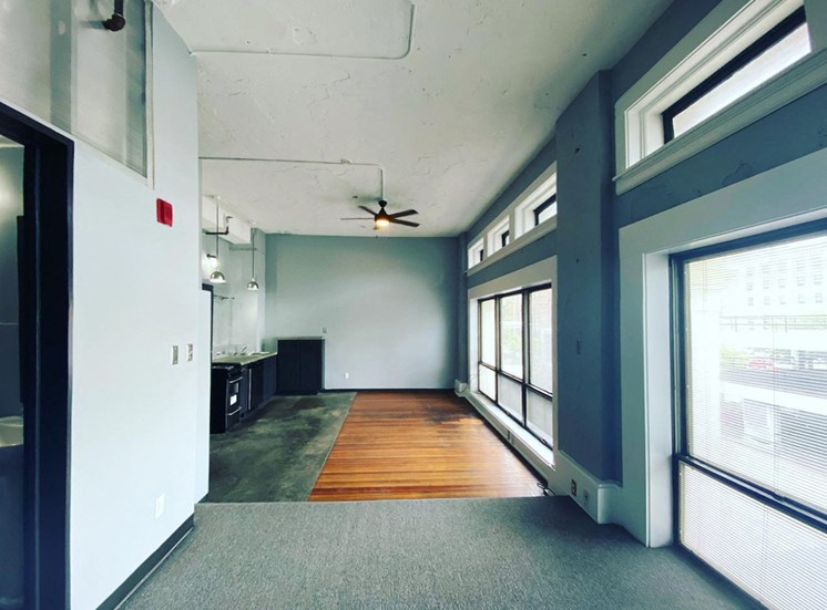 Large loft high ceilings, ceiling fan, and large windows