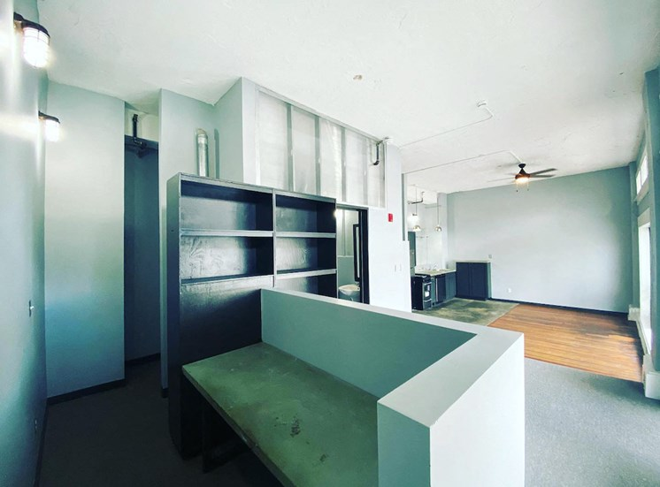 loft with built in shelving and seating