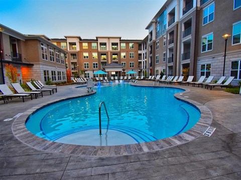 Pool Side Relaxing Area With Sundeck at Pointe at Lake CrabTree, Morrisville