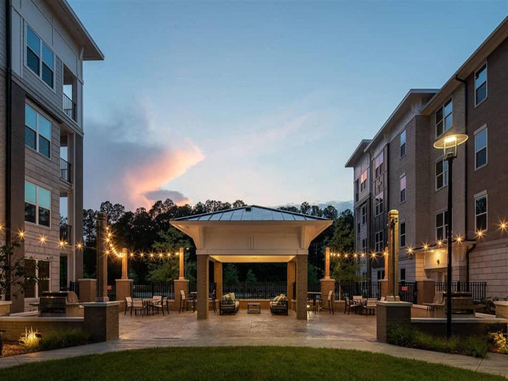 Outdoor courtyard with fire pit at Pointe at Lake CrabTree, Morrisville