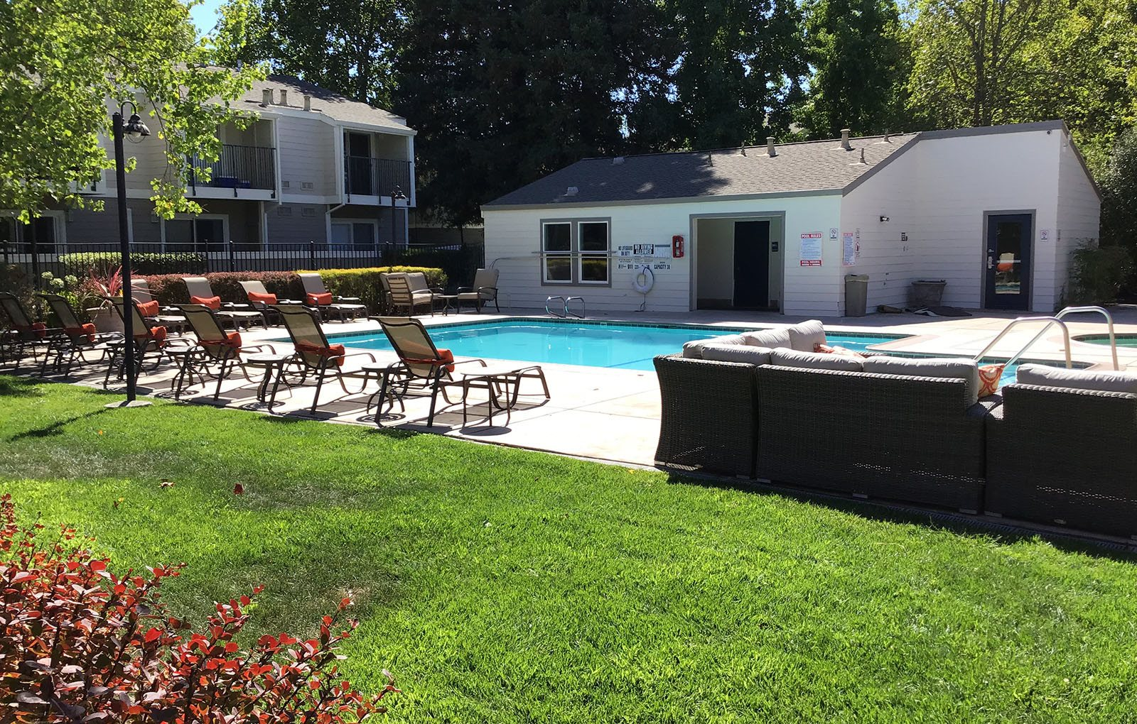 Vineyard Gardens Pool with lounge chairs and couch