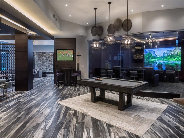 pool table and movie theater in clubhouse