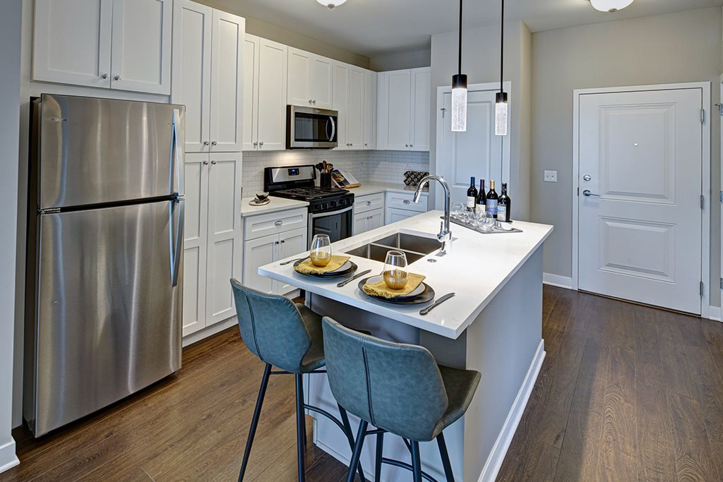 Well Equipped Kitchen And Dining at Marq on Main, Lisle, Illinois
