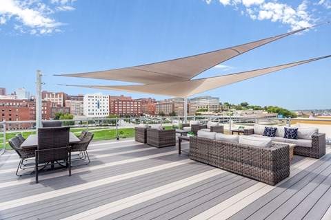 Rooftop patio space with skyline views and firepits