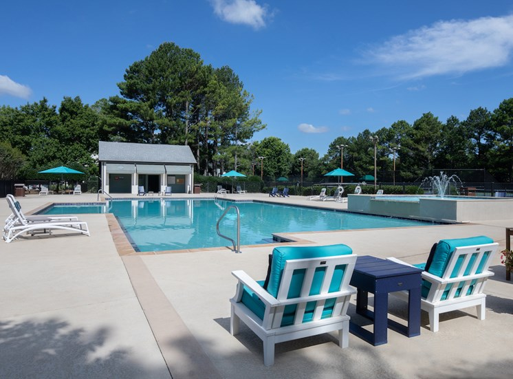 Large pool with deck chairs, lounges, and cabana
