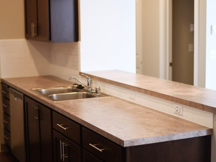 Renovated Bathrooms With Quartz Counters at The Brix Apartments, Spokane Valley, WA