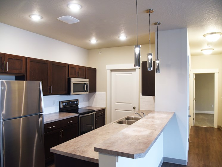 Modern Kitchen With Stainless Steel Appliances And Double Door Refrigerators at The Brix Apartments, Spokane Valley