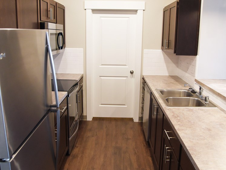 Kitchens With High-Quality Countertops at The Brix Apartments, Washington