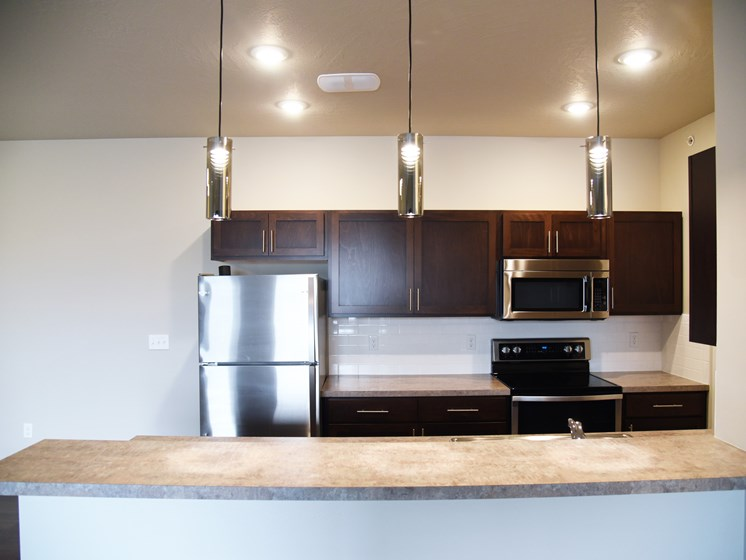 Kitchen Area With Modern Lighting at The Brix Apartments, Spokane Valley