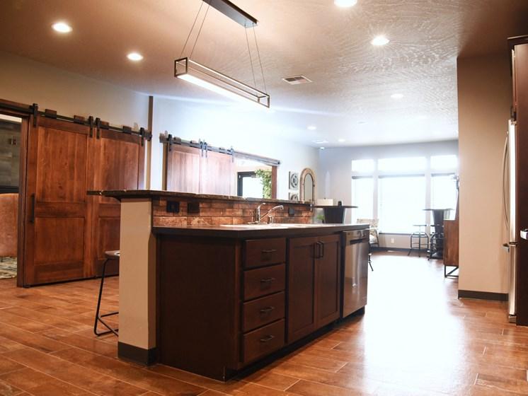 Kitchen With Breakfast Bar at The Brix Apartments, Washington