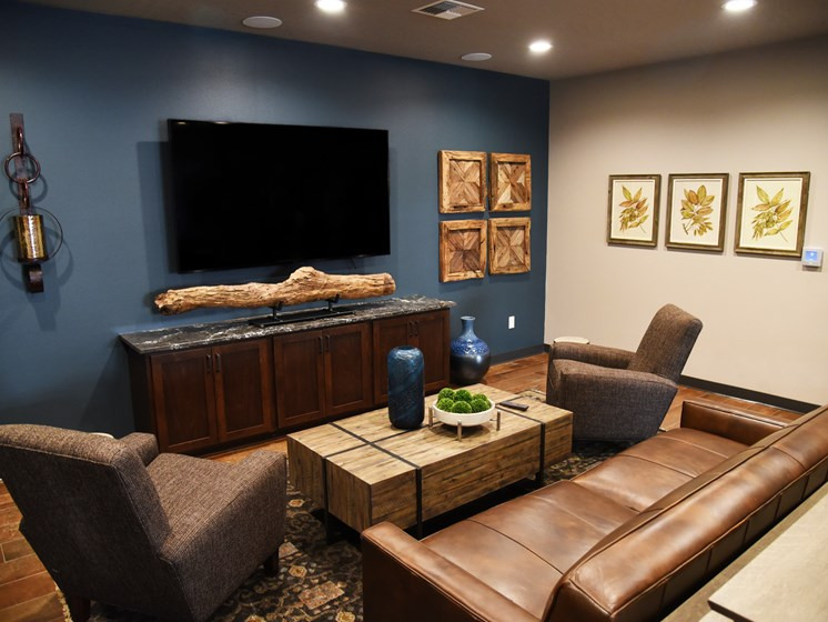 Club Room With Large Screen Television at The Brix Apartments, Spokane Valley, WA