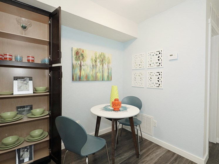 Picture of a dining room with pantry and table