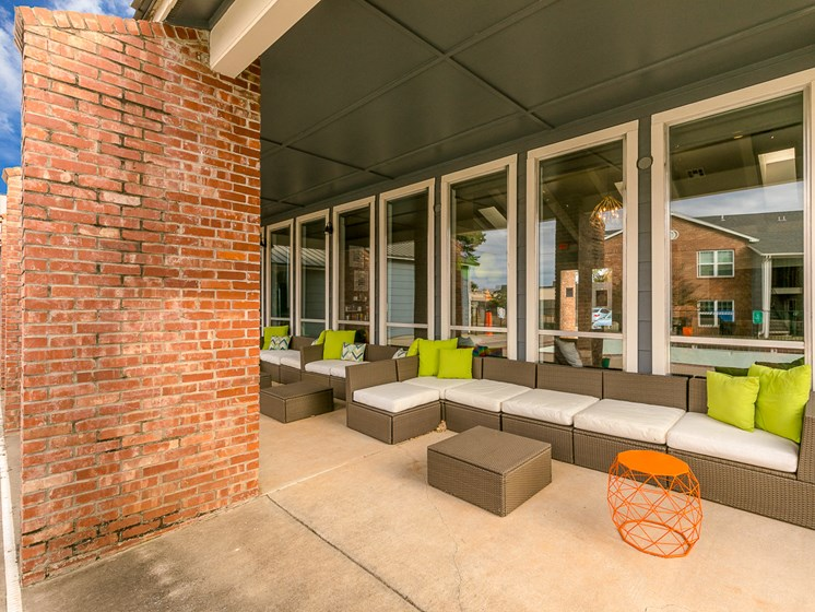 Exterior view of clubhouse with lounger at Bennett Ridge Apartments in Oklahoma City, Oklahoma