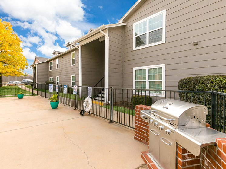 Exterior view of apartment building and grill at Bennett Ridge Apartments in Oklahoma City, Oklahoma