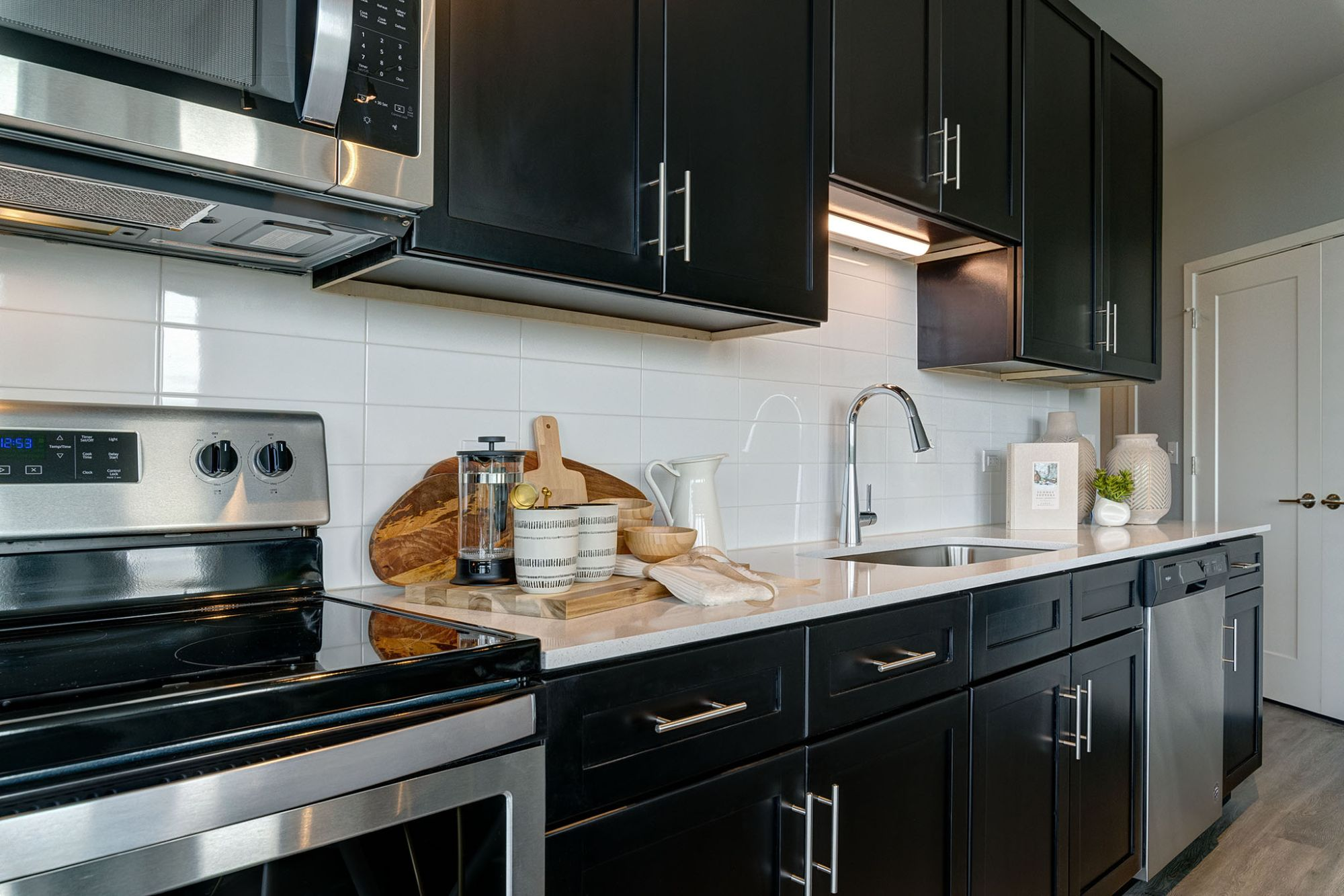 Kitchen cabinets with stainless steel stove and microwave