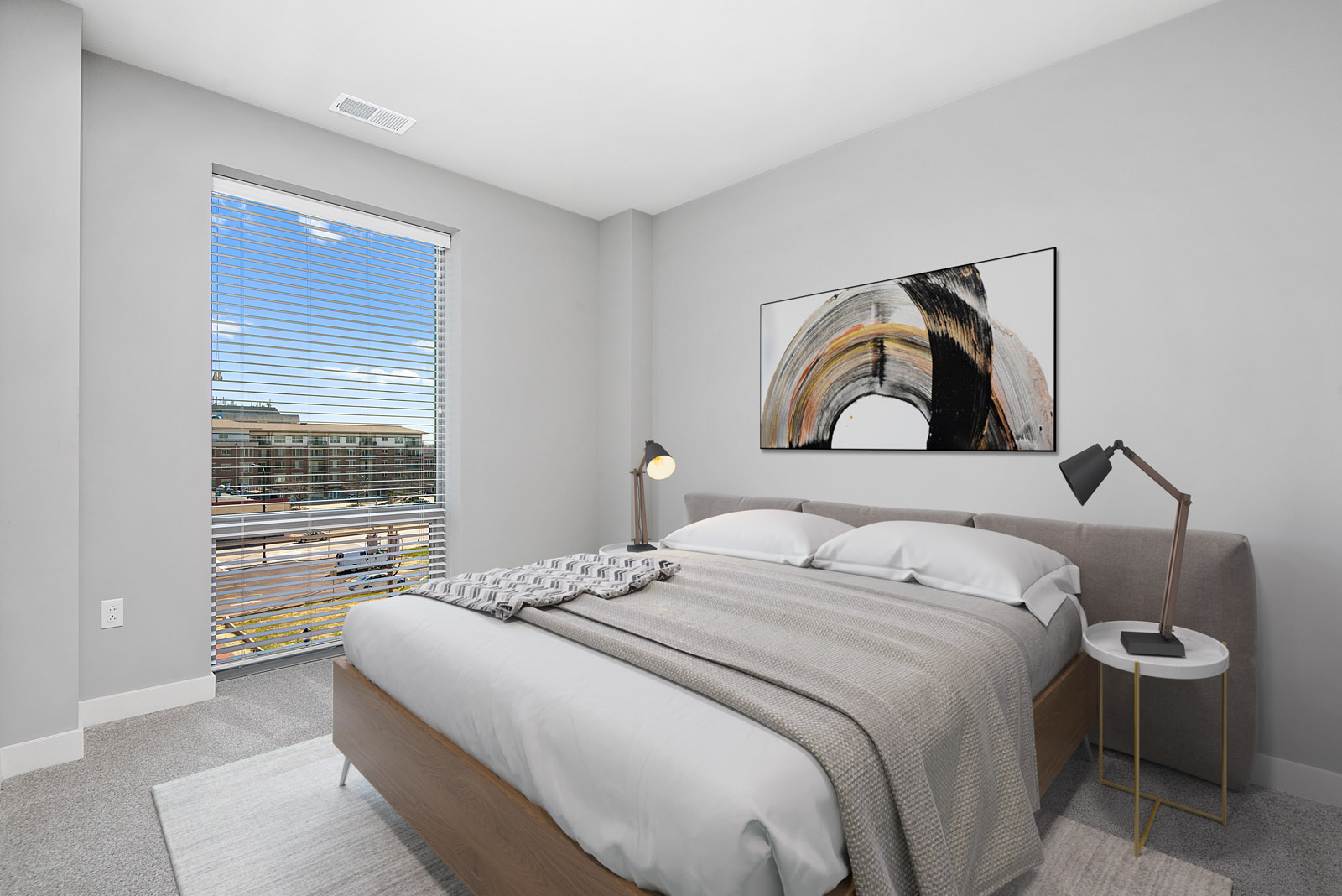 1 bedroom with queen sized bed, two nightstands and large window