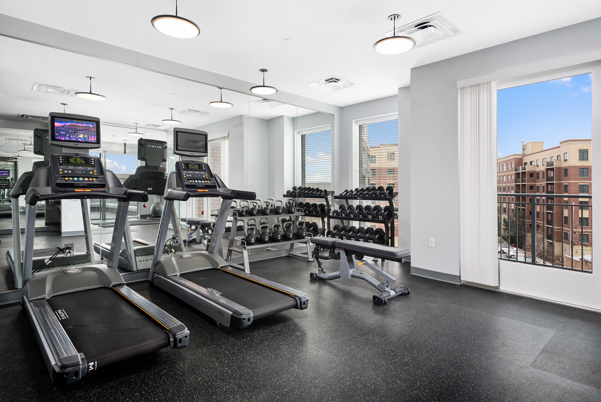Two treadmills and free weights in the fitness center