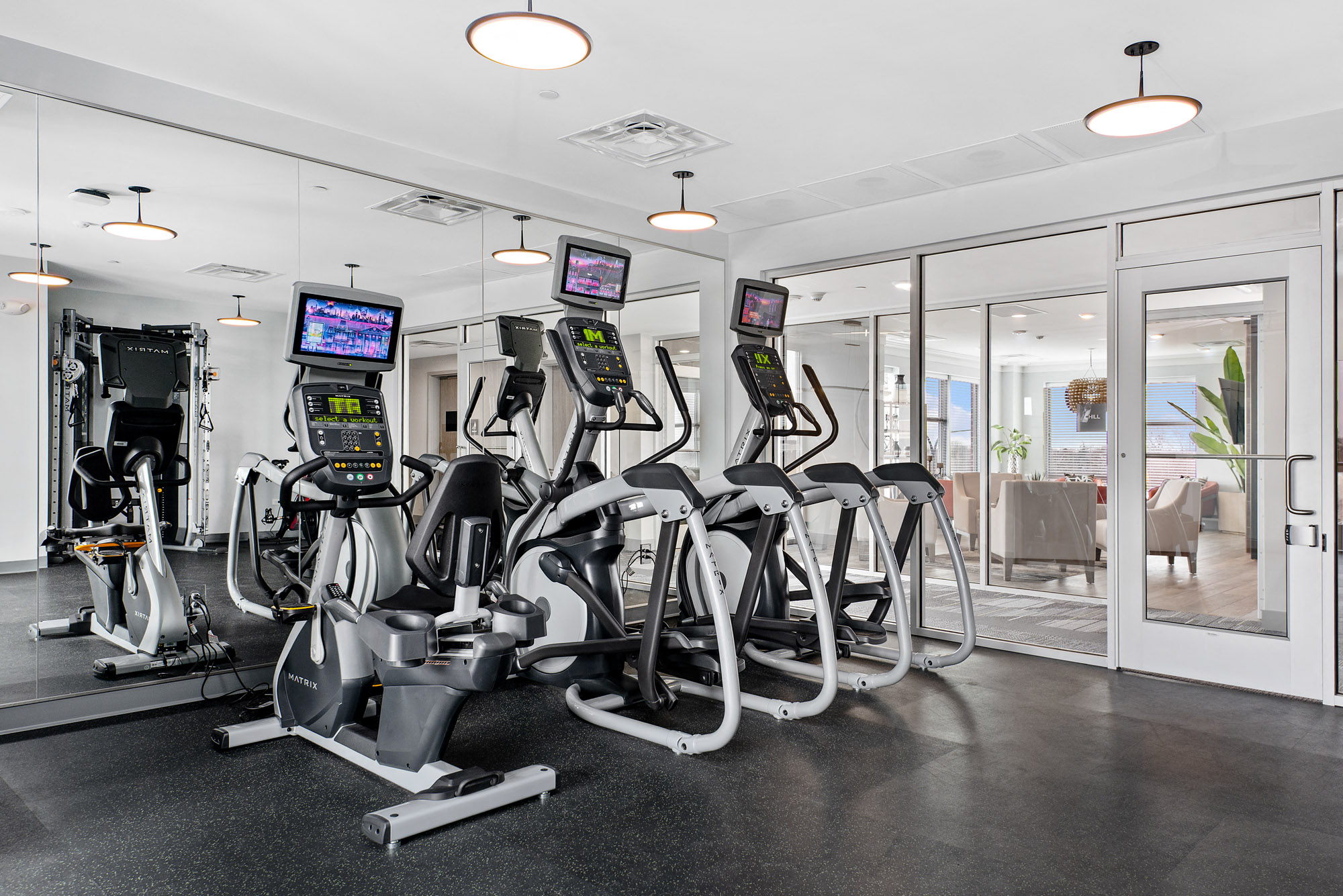 Exercise equippment in the fitness center including ellipticals