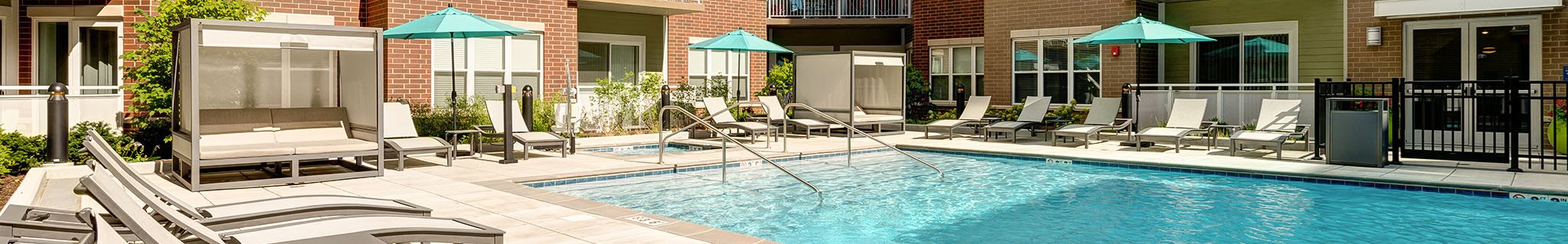 Outdoor swimming pool with lounge chair seating