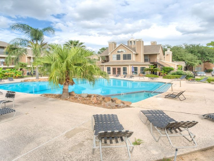 Poolside Relaxing Area at Fairfield Cove Apartments, Houston, TX, 77090