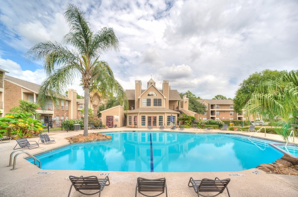 Swimming Pool With Lounge Chairs at Fairfield Cove Apartments, Houston, TX, 77090