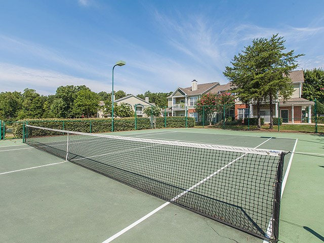Lighted Tennis Court at Reserve at Bridford Apartments in Greensboro