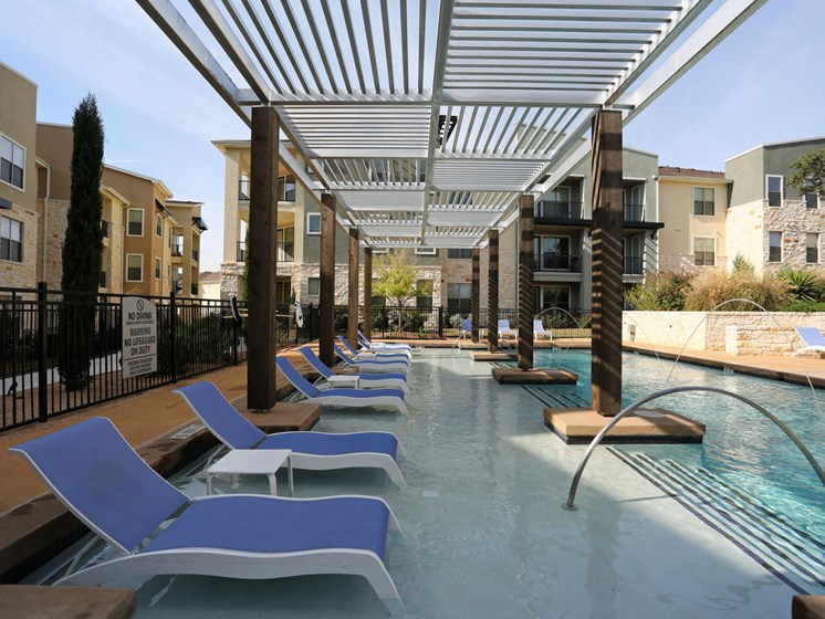 Swimming Pool with Lounge Chairs at The Allure, Texas, 78613
