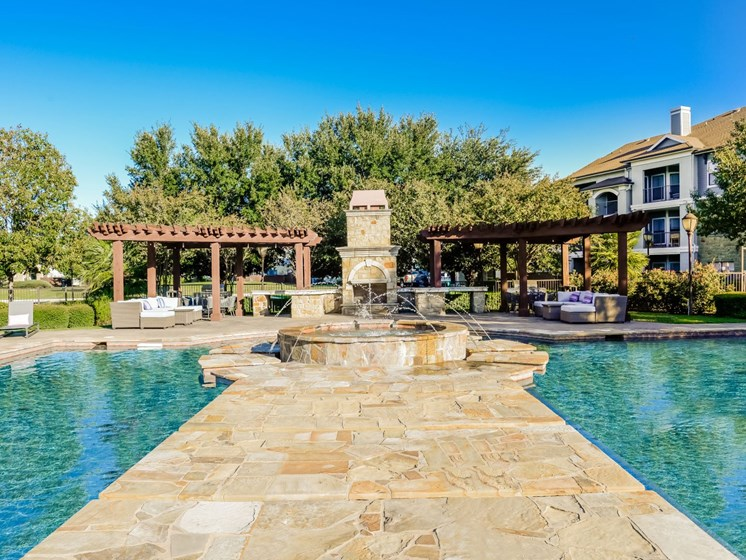 Lavish Pool and Outdoor Lounge with Fire Feature at Palm Valley, Round Rock, Texas