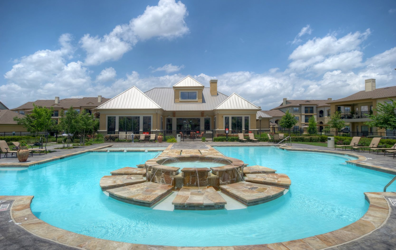 Resort-Style Swimming Pool with Tranquil Fountain at Palm Valley Apartments, Round Rock