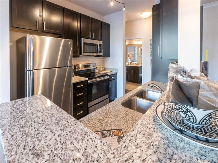 Granite Counter Tops In Kitchen at The Village at Marquee Station, Fuquay-Varina, 27526